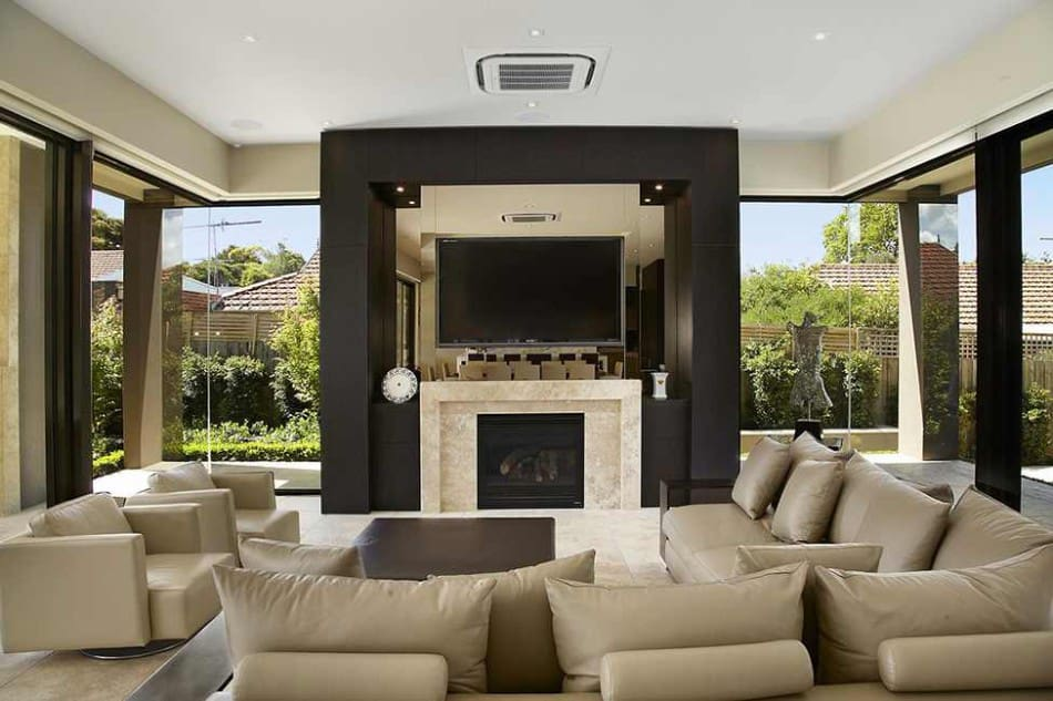 modern living room with fireplace and tv. View In Gallery Luxury-melbourne-home-with-pillared-entry-and-interior-. Overlooking The Kitchen, Living Room Centers Around A Modern Fireplace With And Tv D