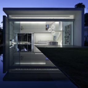 Minimal House With Hangar-Style Rear Facade