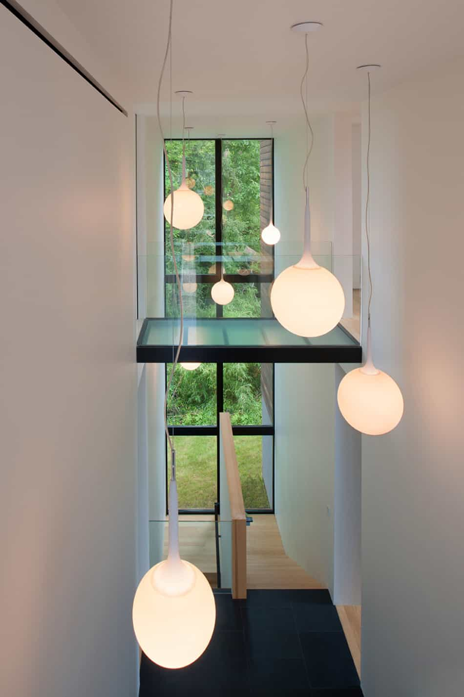 View in gallery modern box house with interior glass bridges 13
