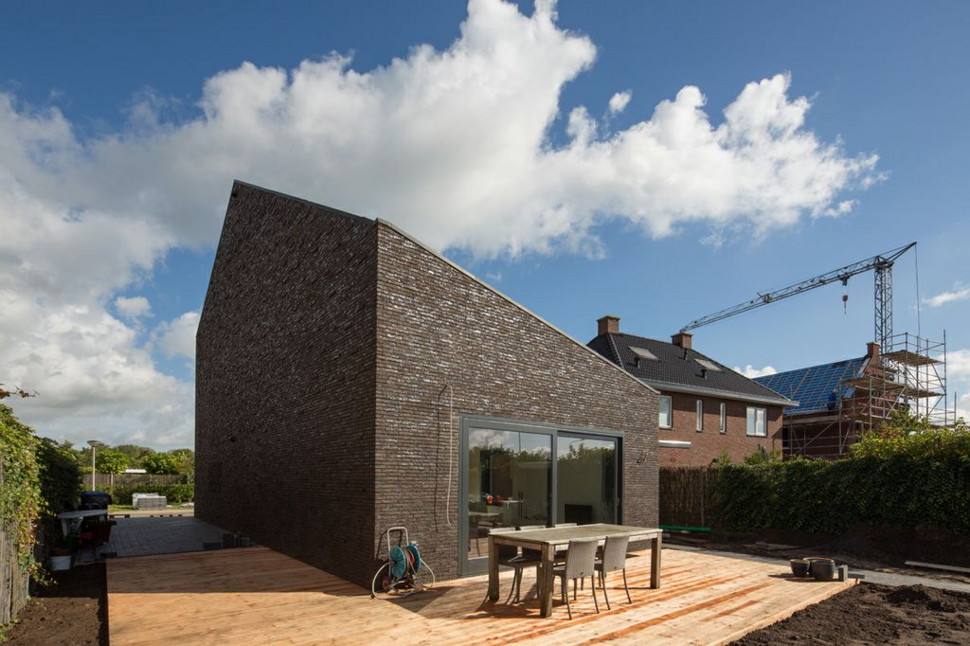 Modern family home in the netherlands tradition with a twist for Modern house design with bricks