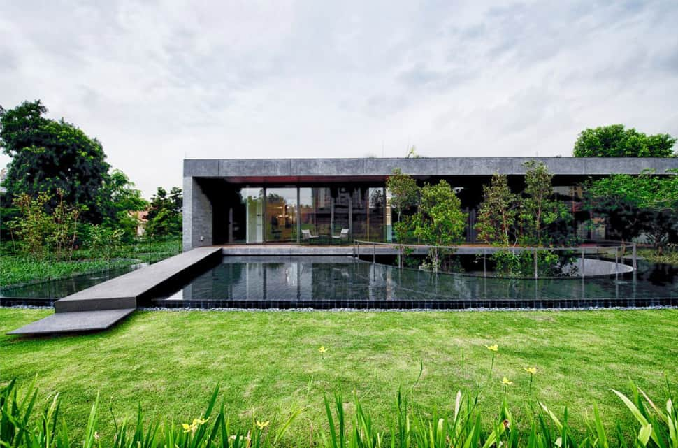 Home with underground courtyard and rooftop gardens for House garden design in punjab