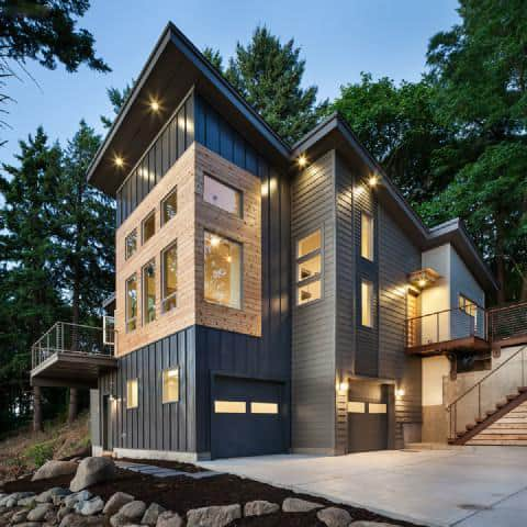 Vertical Mountain Cottage Towers Among The Trees