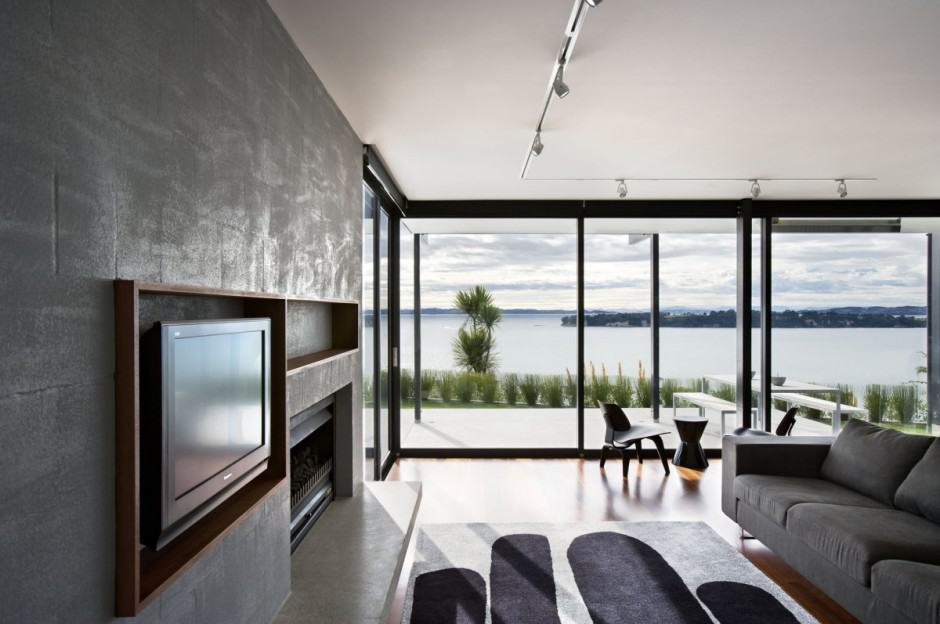 Modern wood panel house on bay front cliff