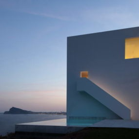 Monolithic House Suspended Above the Sea