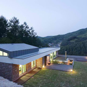Family House Partially Built into the Mountain