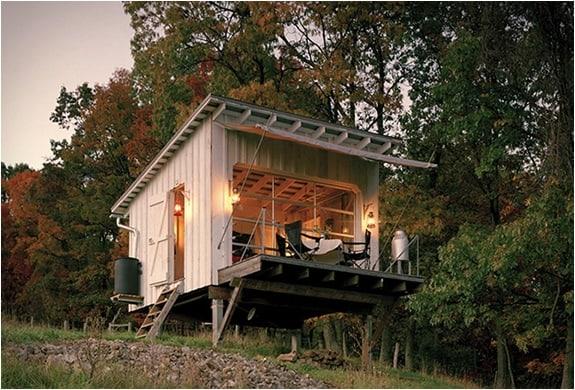 off the grid cabin with glass garage door 1 below
