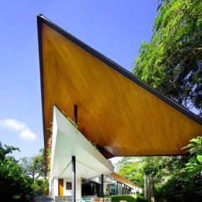 Winged Roof House with outdoor rooms