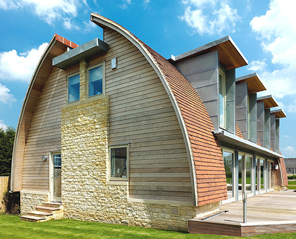Curved roof house plan makes a stylish eco statement for Curved roof house plans