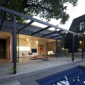 Posh pool house with glass walls