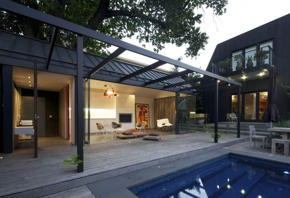 Posh pool house with glass walls for Pool design eltham