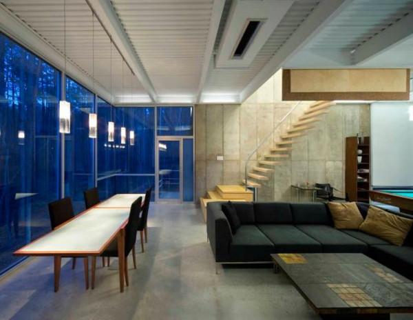Sloped terrain house modern industrial meets nature for Modern industrial house plans