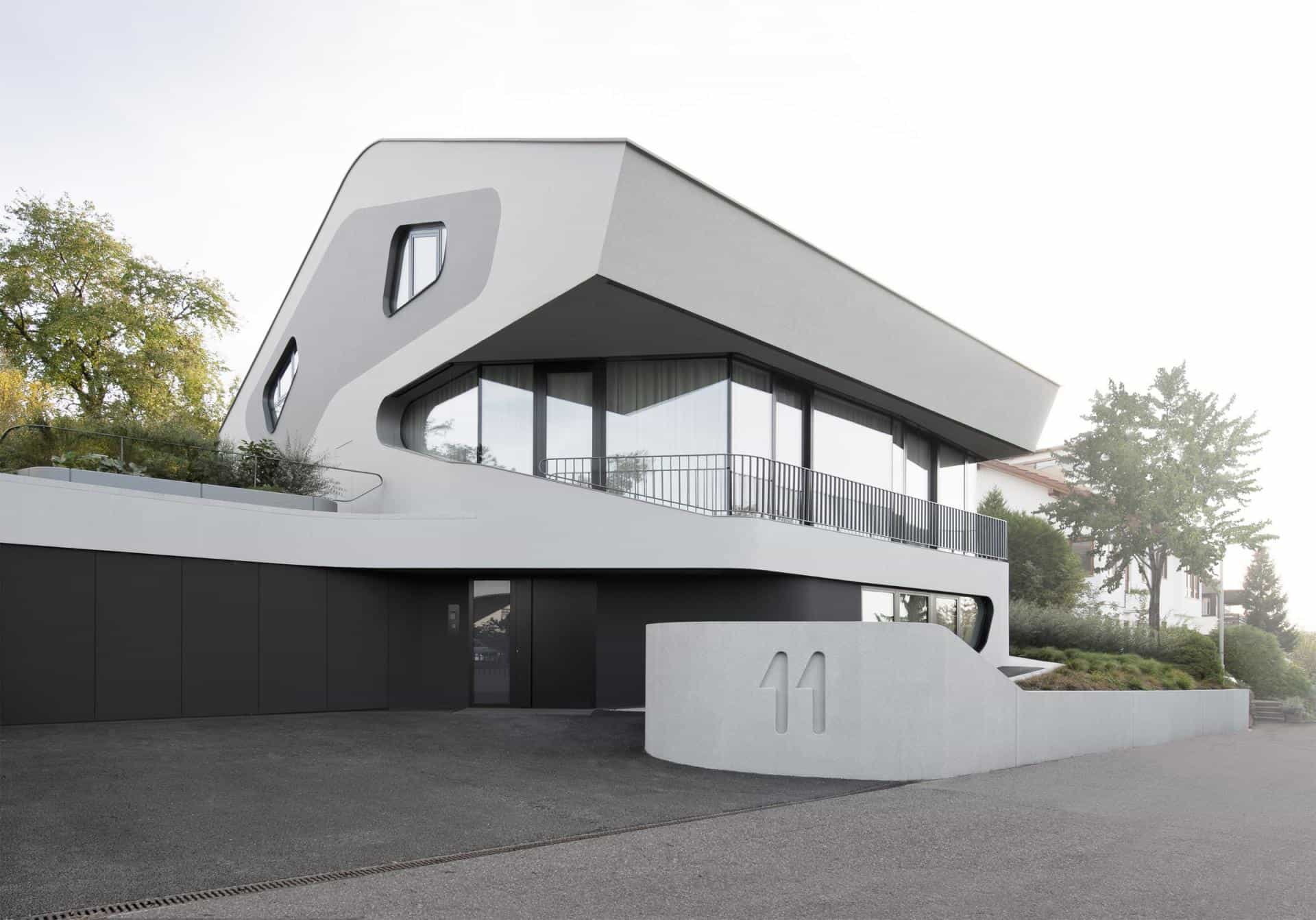 Home Design: Reinforced Concrete House With Aluminum Facade