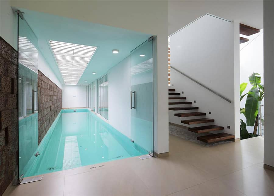 House with privacy brick walls for Badminton court ceiling height