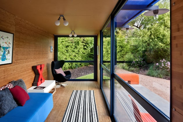 shipping-container-guest-house-with-rooftop-garden-8-main-room-windows.jpg