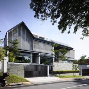 Slatted Facade House With Sleek Adjoined Apartment