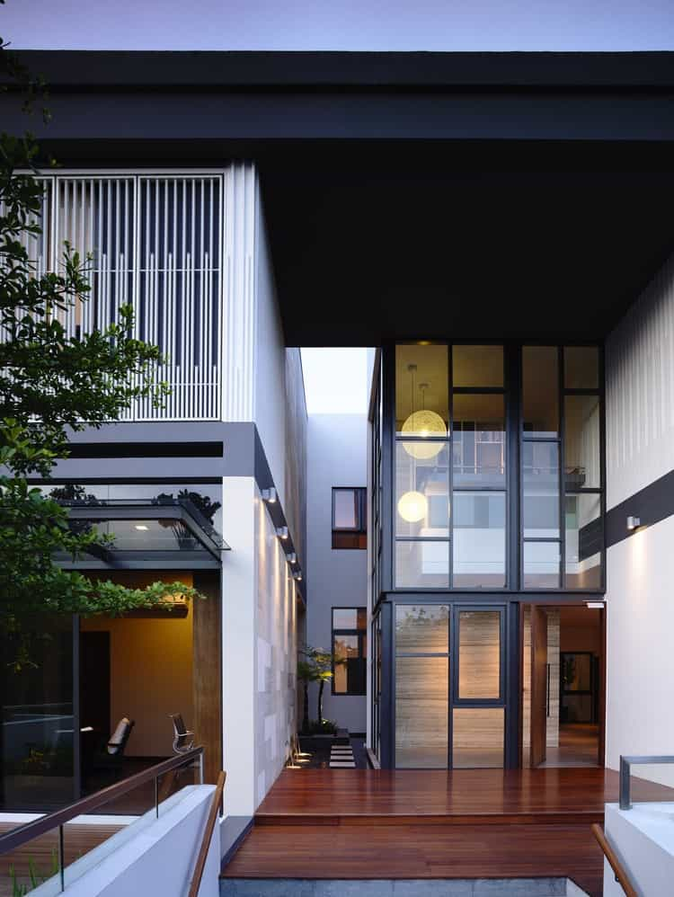 View In Gallery Slatted Facade House With Sleek Adjoined Apartment 7