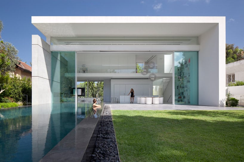 View in gallery sleek-cubic-house-with-front-and-back-gardens-