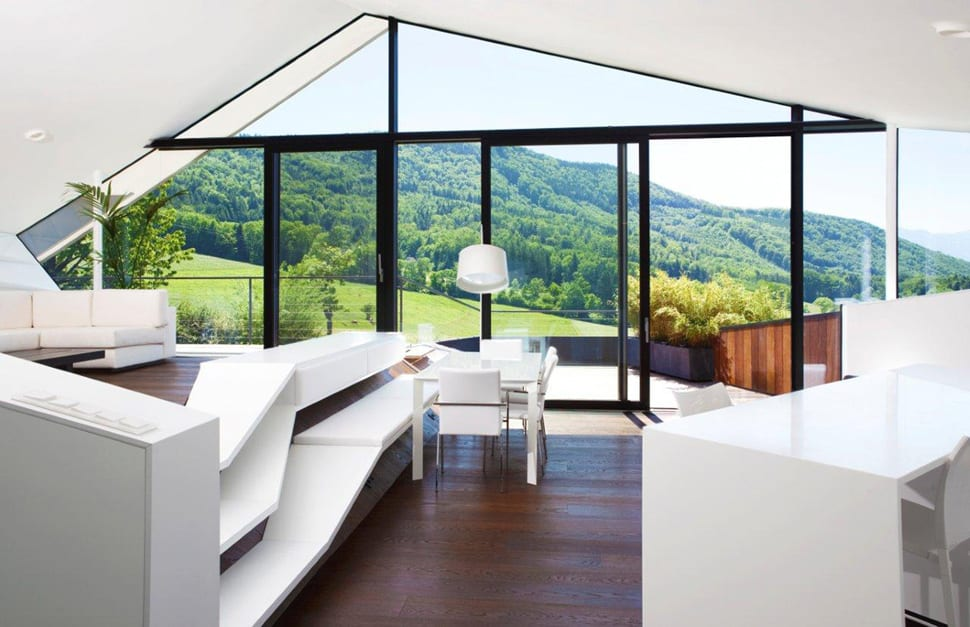 View In Gallery Slope Roof House With Futuristic Interiors Framing The