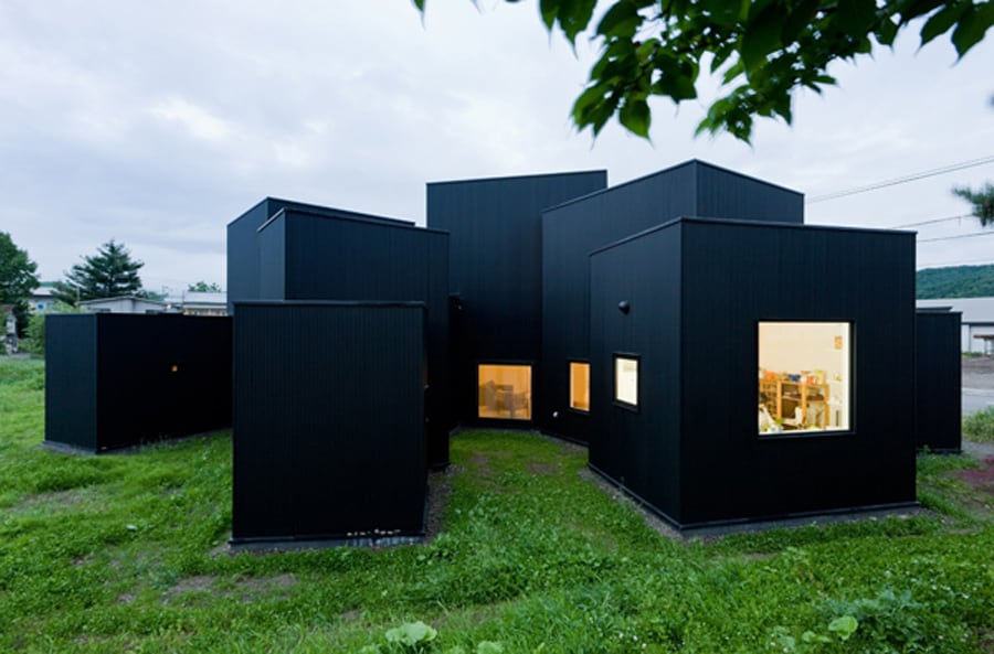 Small house big impact with black facade white interiors - Small homes big space collection ...
