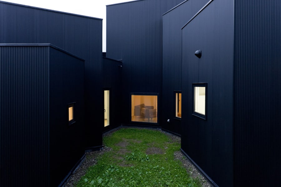 Small House Big Impact With Black Facade White Interiors