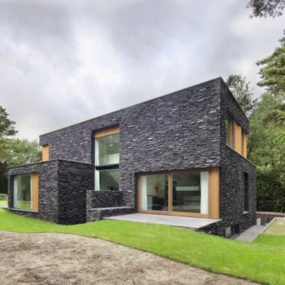 Stone House Siding Blends Beautifully with Nature, in the Netherlands
