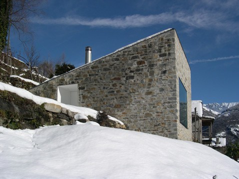 stone house fronts swiss mountains 2