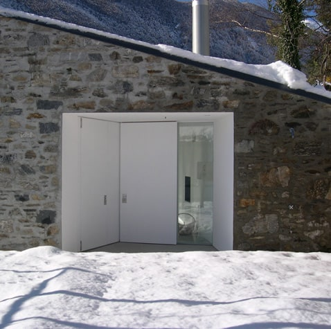 stone house fronts swiss mountains 5