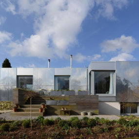 Zero Carbon House with Sliding Reflective Exterior Panels