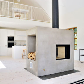 Swedish Loft House with Concrete Fireplace Feature