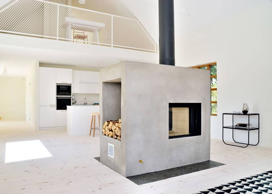 Swedish loft house with concrete fireplace feature for Swedish home design