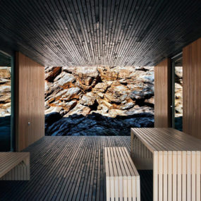Timber Cabin Built into Cliff Side Site