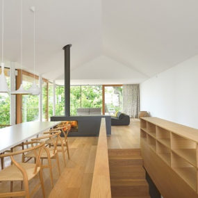Timber Slope House Lined With Glass Walls and Terraces