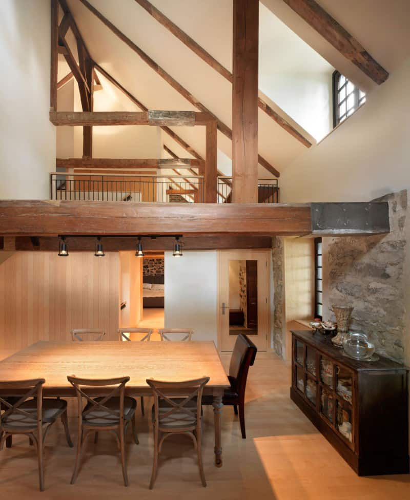 Traditional stone farmhouse extended with glass and steel for Half vaulted ceiling with beams