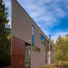 Triangular House with Bridge to Office Loft Overhead