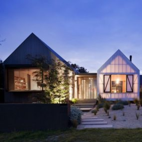 Triple volume coastal home makes a modern neighbor