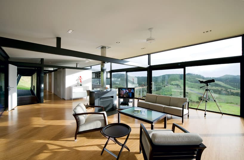 Truss style new zealand glass house with complex interior for Rooms interior design hamilton nz