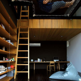 Two-Story Room with Suspended Netting Reading Nook