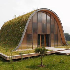 Underground Wave House with Wildflower and Herb Exterior