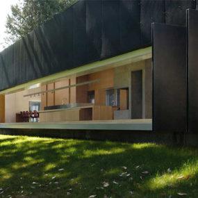 Unusual linear house with open breezeway and luminous ceiling