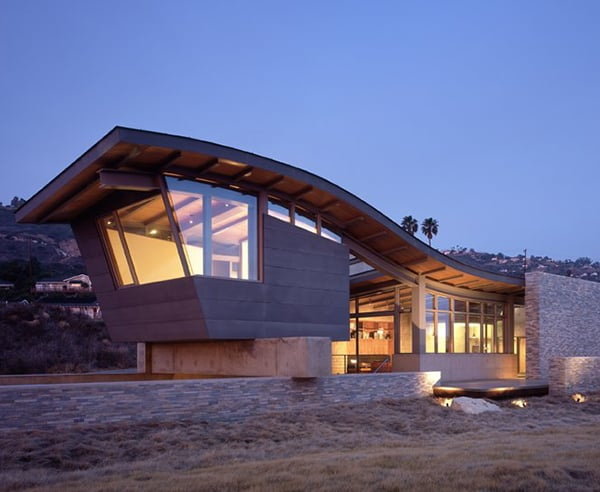 unusual roof design adds interest to beach house - Unusual Beach House Plans