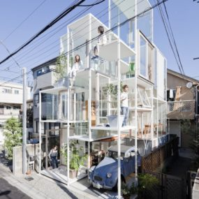 Urban Glass-Walled House With Platform Living Spaces