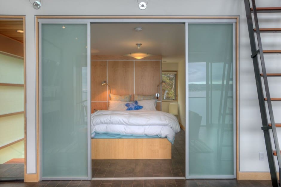 ... sliding translucent glass doors. View in gallery ... & Tsunami-proof Waterfront House