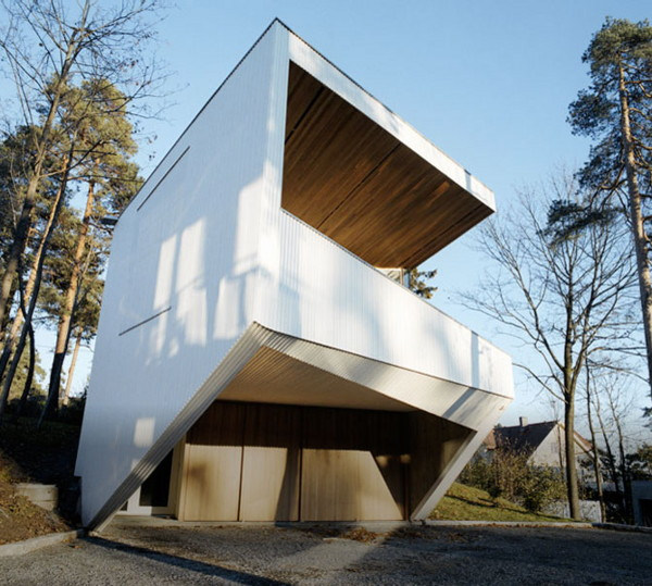 norway ultra modern  geometric white house in the woods of