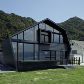 Wood and glass house with ocean and mountains for neighbors