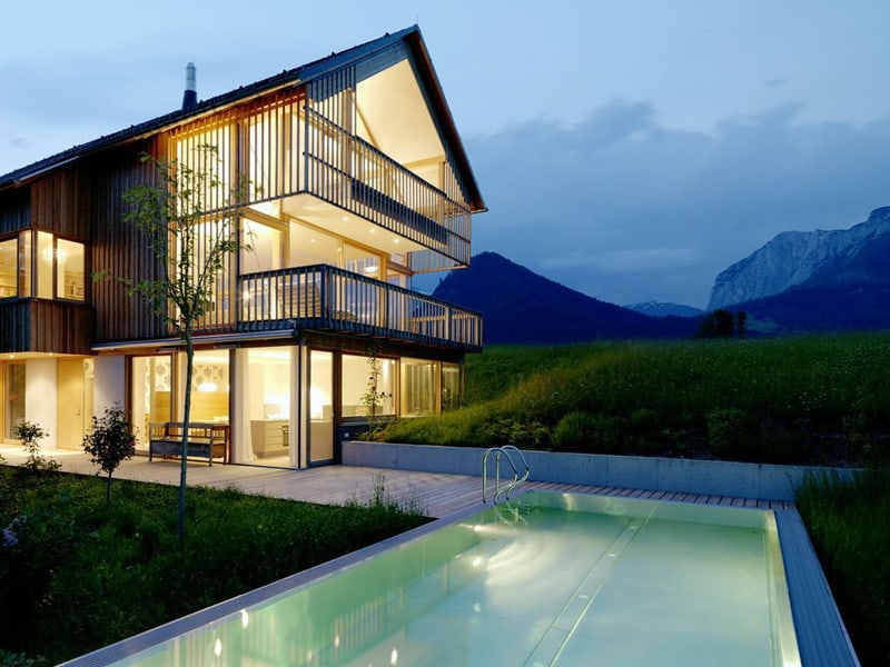 Wood and Glass Mountain House with Trio of Terraces