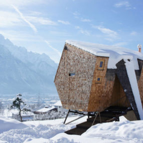 Wood Shingled Austrian Mountain House with Sloped Walls