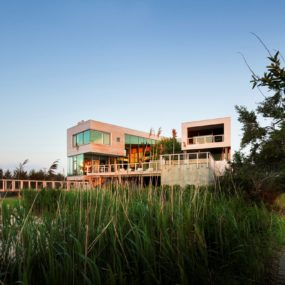 Wooden Waterfront House Featuring Built-In Patio