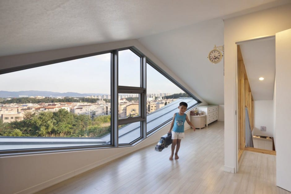 attic dormer ideas - Zigzag house with panoramic views and a slide inside