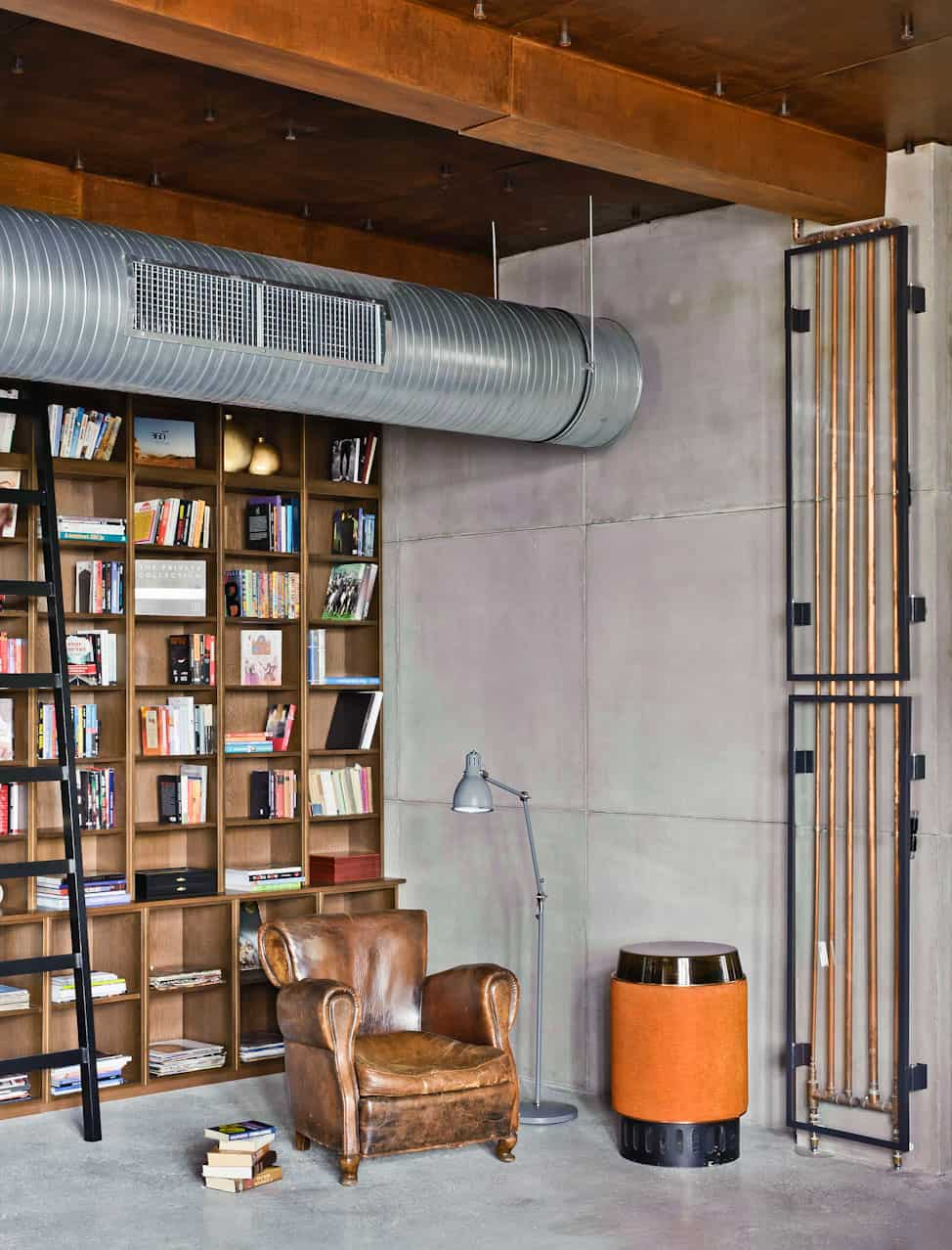 view in gallery eclectic loft apartment budapest shay sabag 7 bookshelf