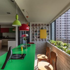 Apartment Decorated with Green, Red and Yellow Accents